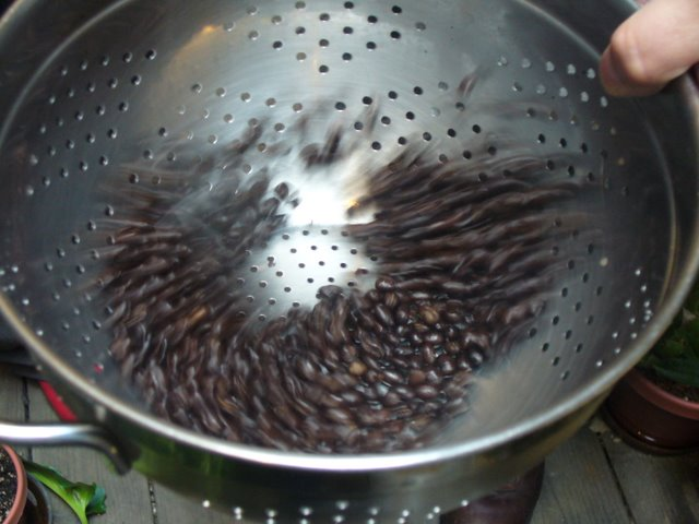 cooldown the coffee using a colander